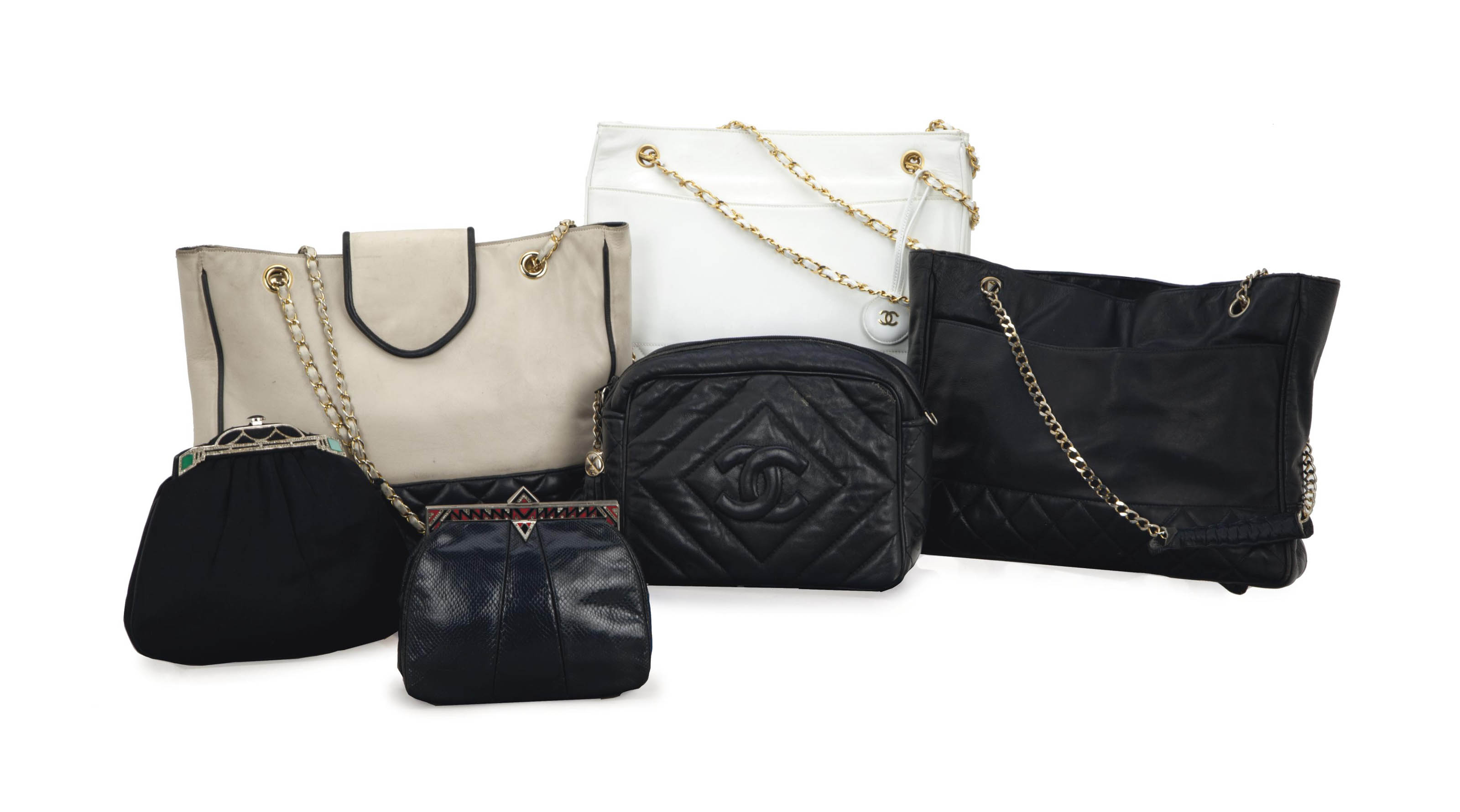 TWO BLACK QUILTED-LEATHER HAND