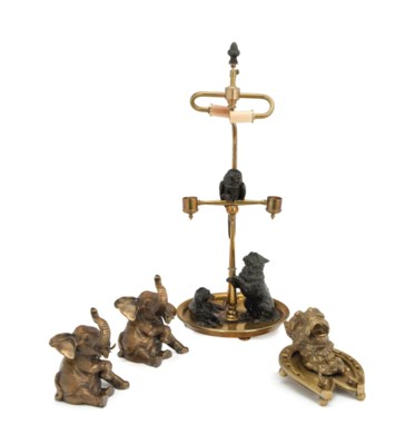 A BRASS TABLE LAMP MOUNTED WIT