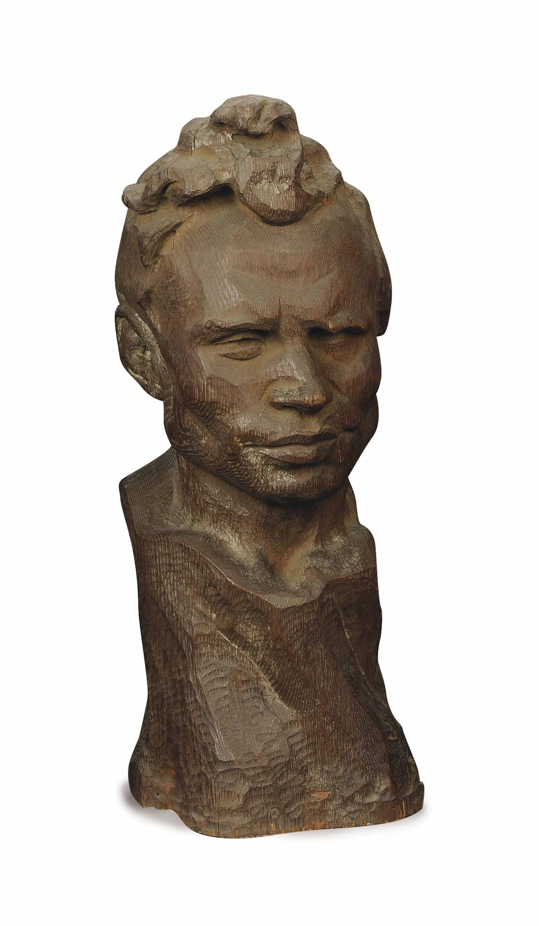 A CARVED OAK HEAD OF A MAN,