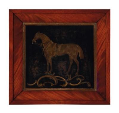 A GILT-BRASS RELIEF OF A HORSE