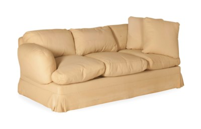 A BEIGE PLUSH-UPHOLSTERED THRE