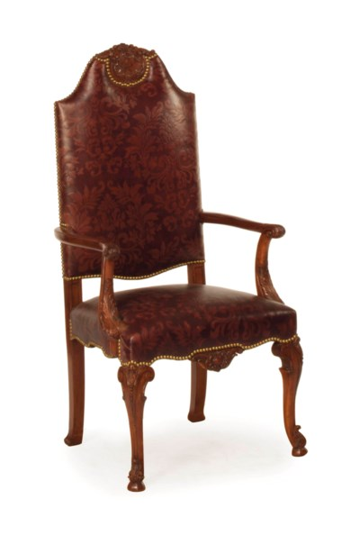 A GERMAN MAHOGANY AND EMBOSSED
