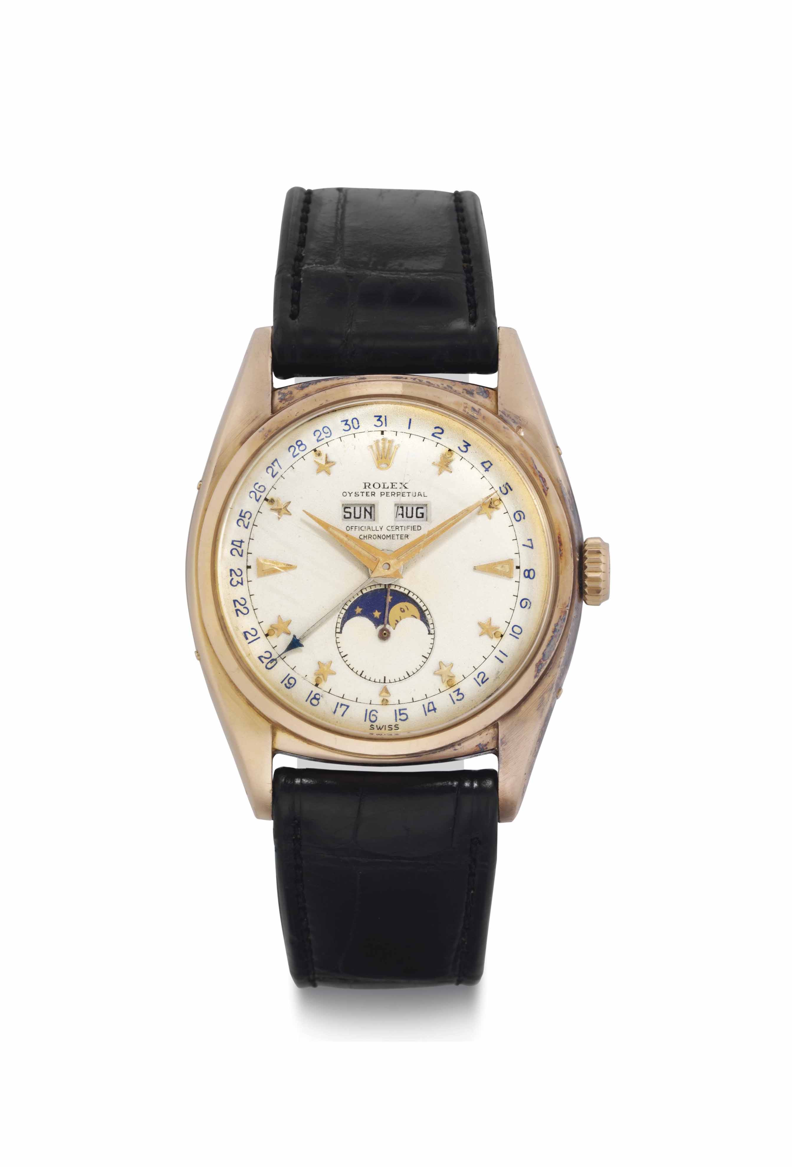 Rolex. A Very Fine and Extremely Rare 18k Pink Gold Automatic Triple Calendar Wristwatch with Star Dial and Moon Phases