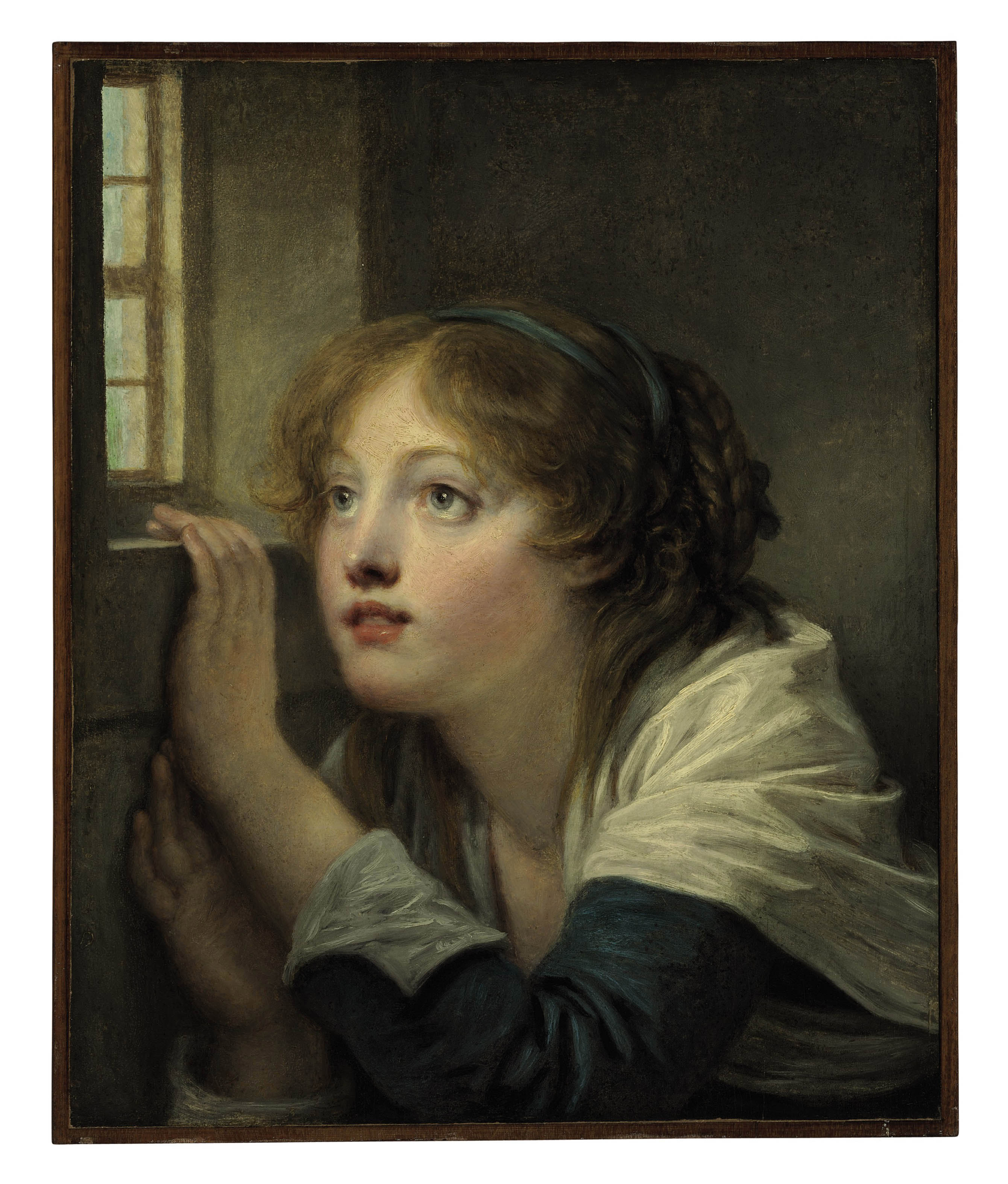 A young girl at a window