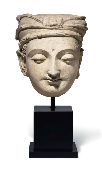 A large stucco head of a bodhi