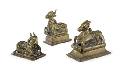 A group of brass figures of Na