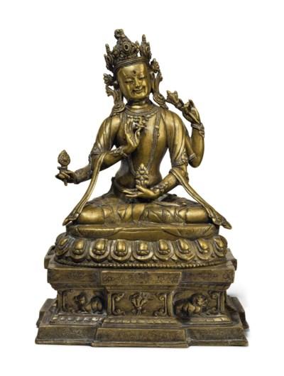 A bronze figure of a Bon deity