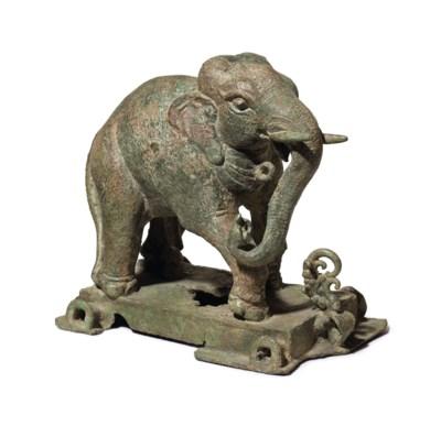 A bronze figure of an elephant