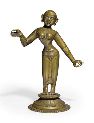 A brass figure of Radha