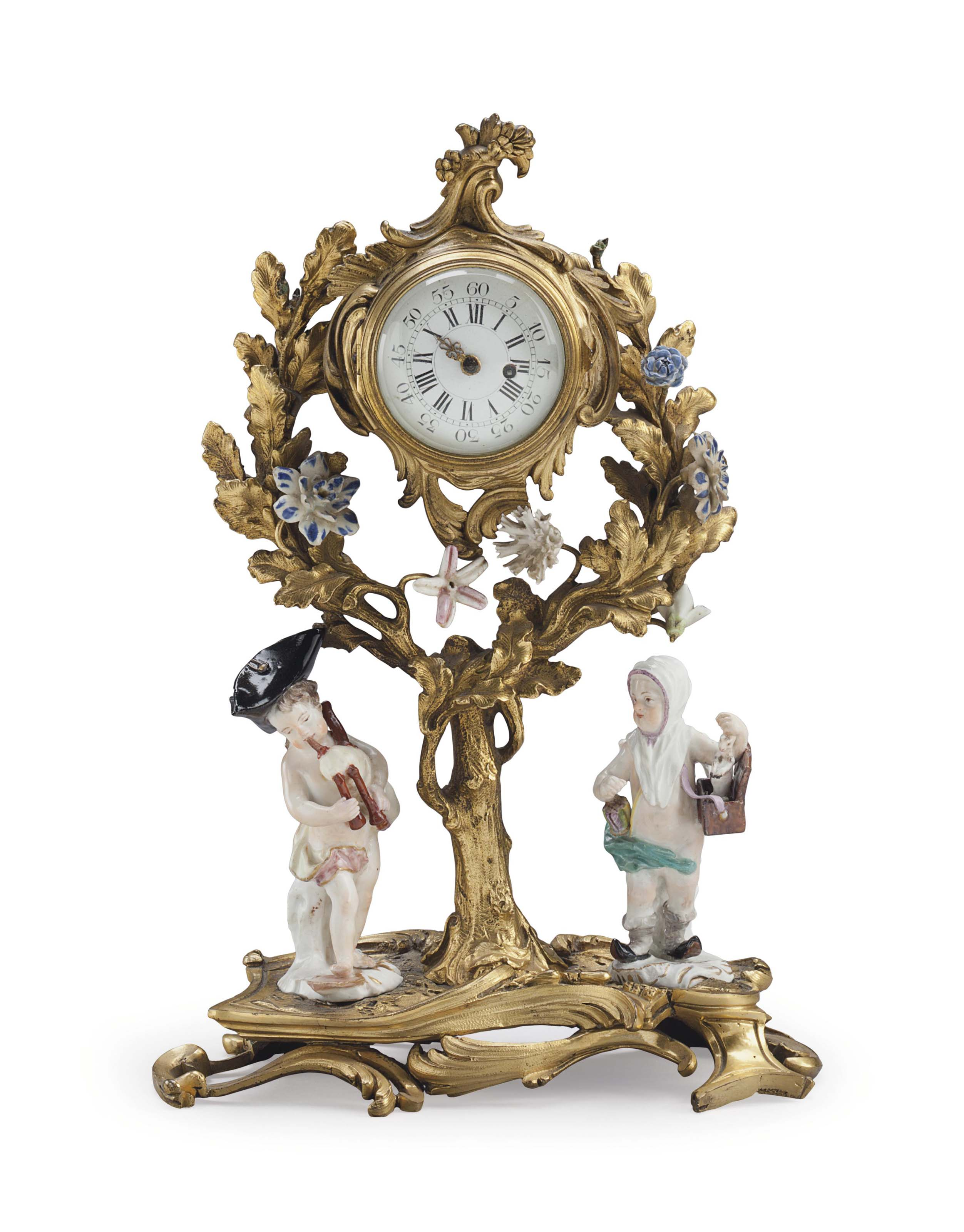 A FRENCH GILT-BRONZE AND PORCE