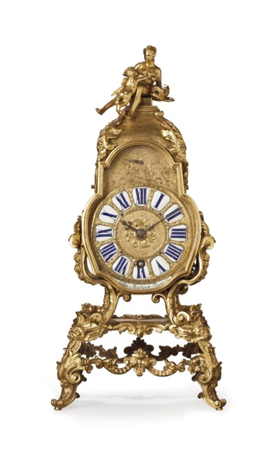 A REGENCE ORMOLU MANTEL CLOCK
