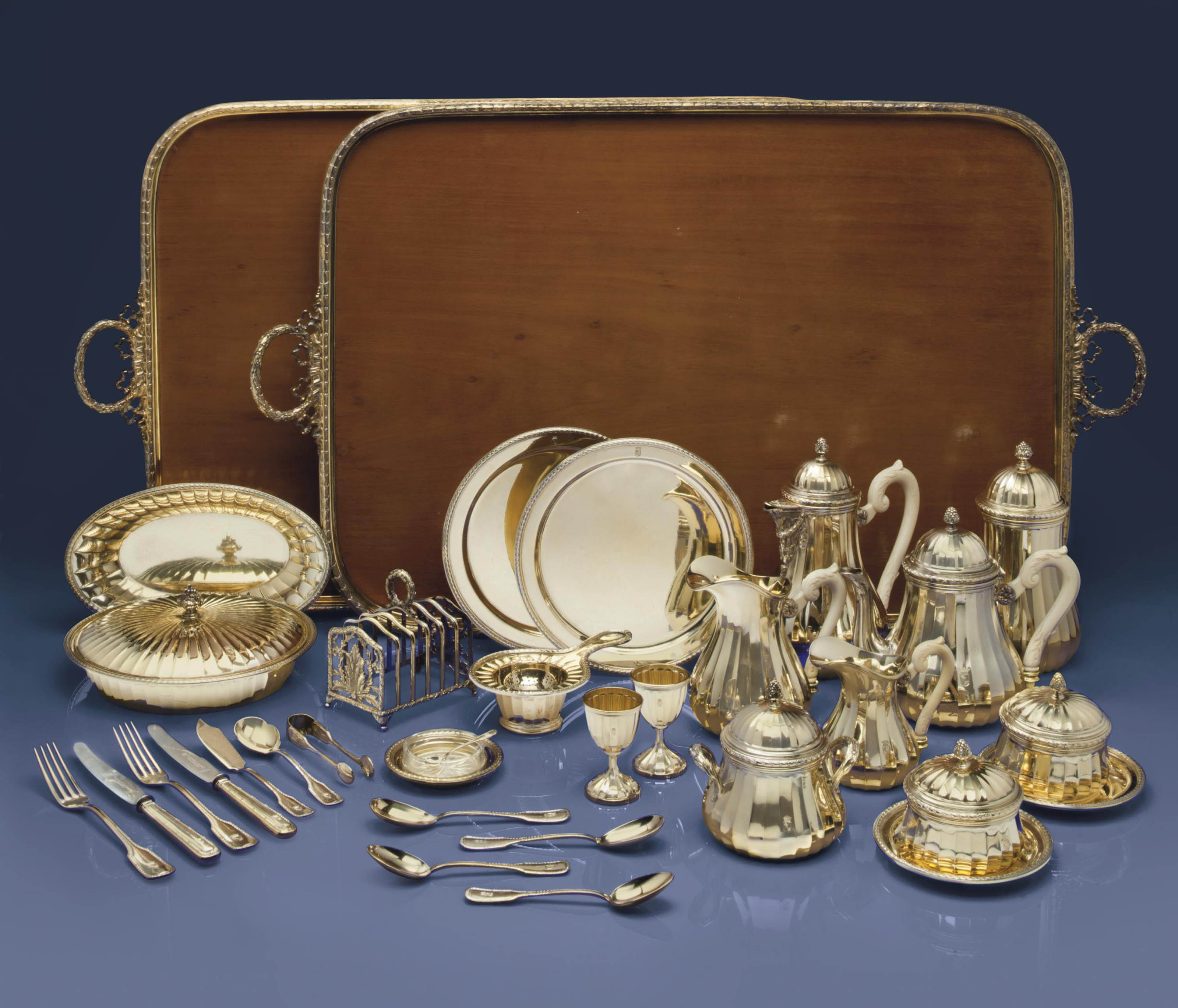 A GERMAN SILVER-GILT BREAKFAST SERVICE IN TWO FITTED CASES