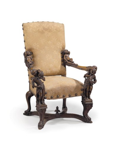 AN ITALIAN OAK OPEN ARMCHAIR