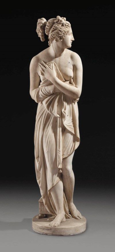 A WHITE MARBLE FIGURE OF VENUS