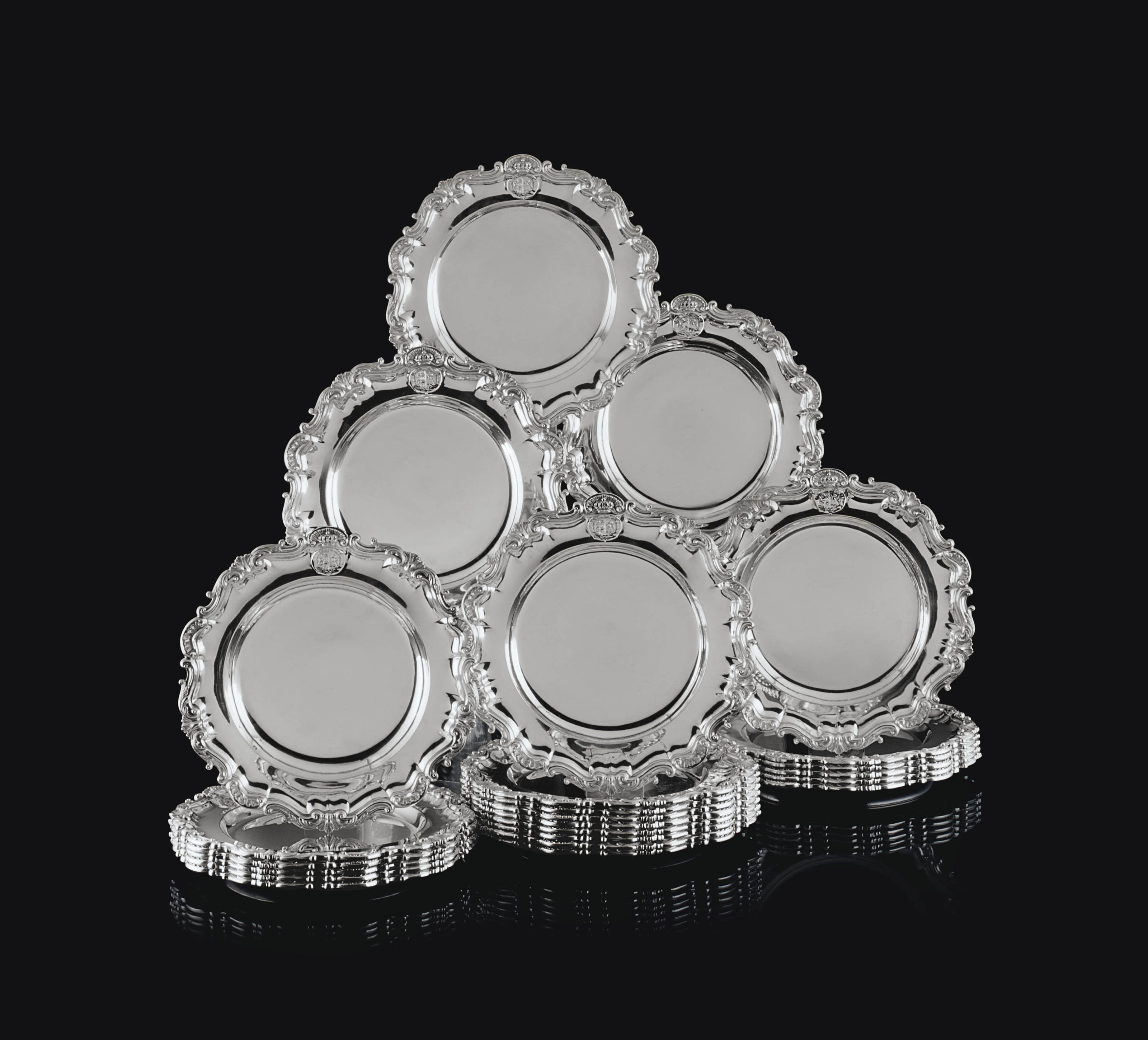 A SET OF TWENTY-FOUR EARLY VICTORIAN SILVER DINNER PLATES
