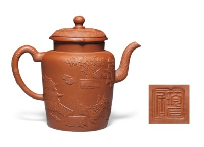 A BROWNISH-RED YIXING TEAPOT A