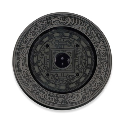 A BRONZE CIRCULAR MIRROR WITH