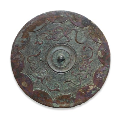 A BRONZE CIRCULAR 'DRAGON AND
