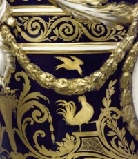 A PAIR OF SEVRES PORCELAIN BLEU NOUVEAU TWO-HANDLED VASES AND COVERS
