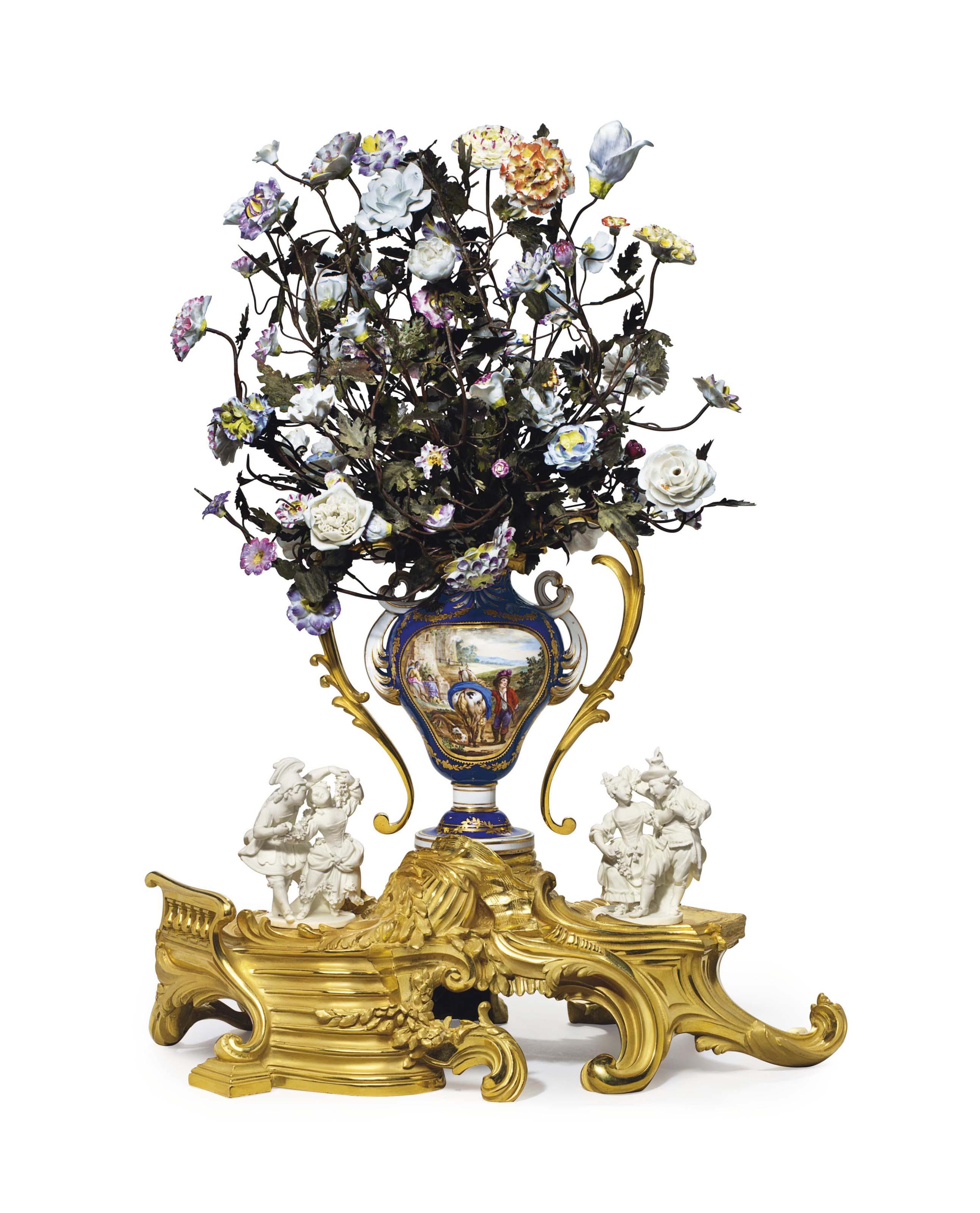 AN ASSEMBLED ORMOLU-MOUNTED SEVRES BLEU NOUVEAU AND BISCUIT PORCELAIN CENTERPIECE (LE BOUQUET DE LA DAUPHINE)