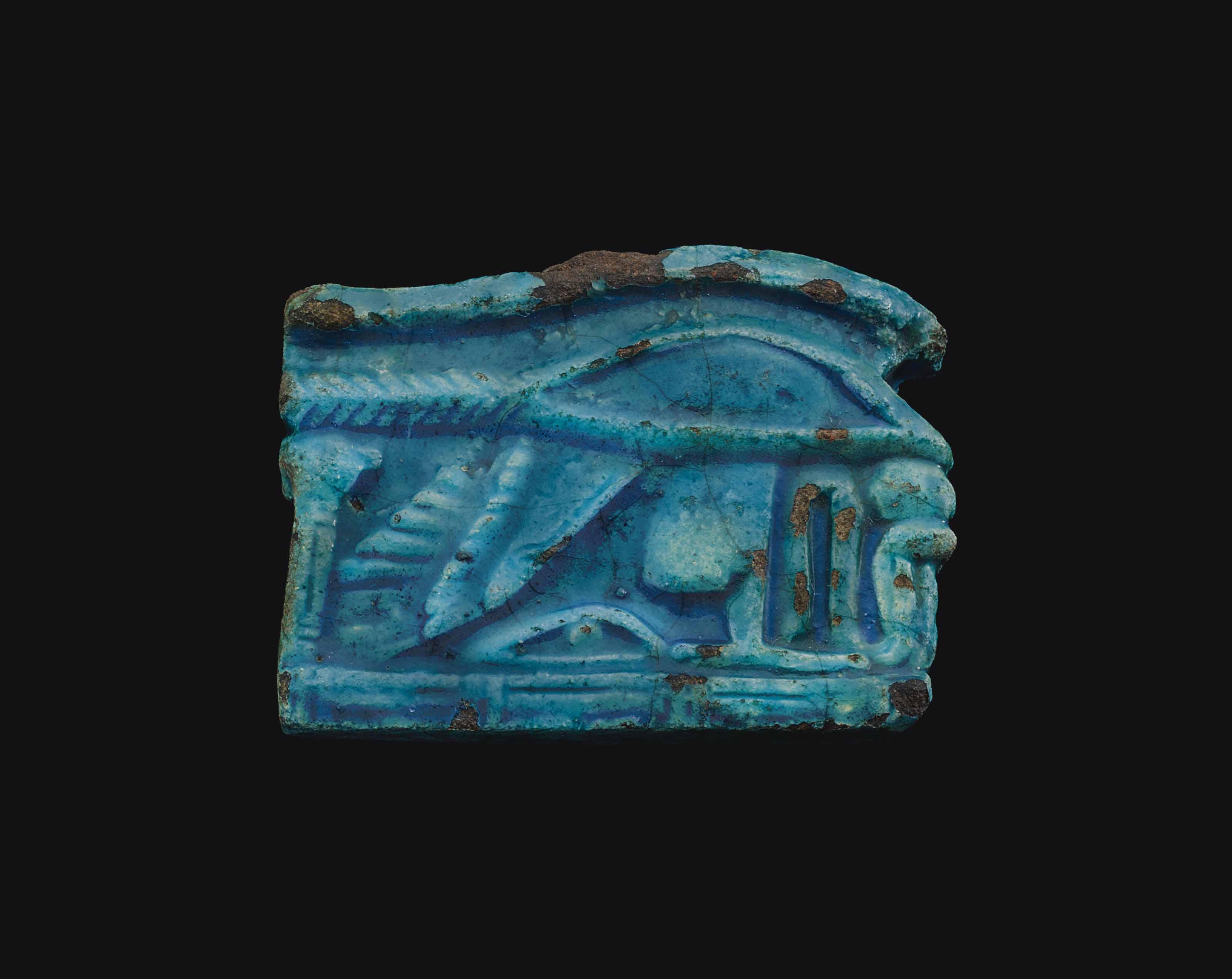AN EGYPTIAN FAIENCE WEDJAT-EYE