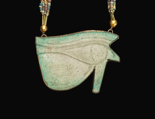 AN EGYPTIAN FAIENCE WEDJAT-EYE