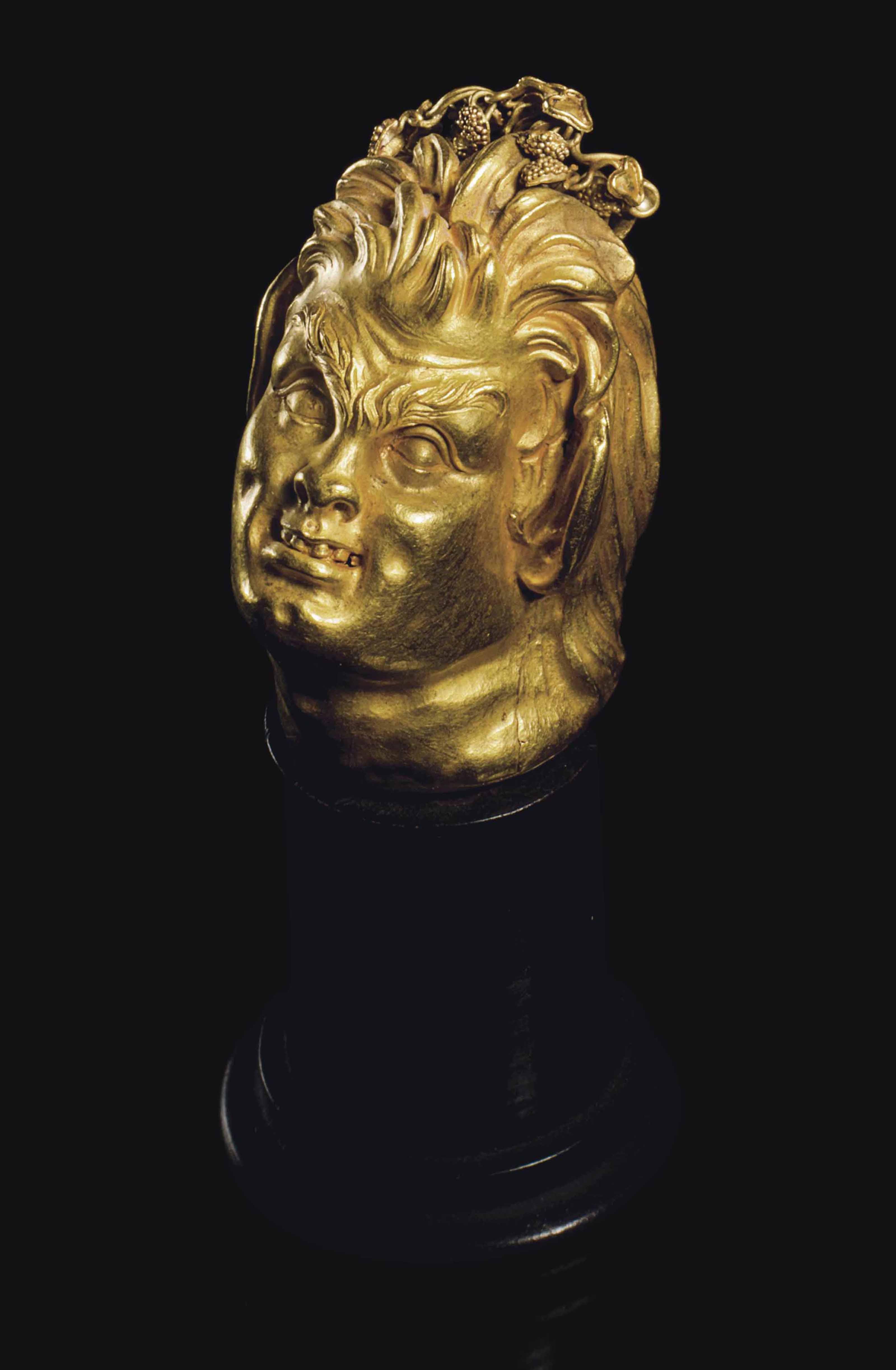 A GREEK GOLD HEAD OF A SATYR