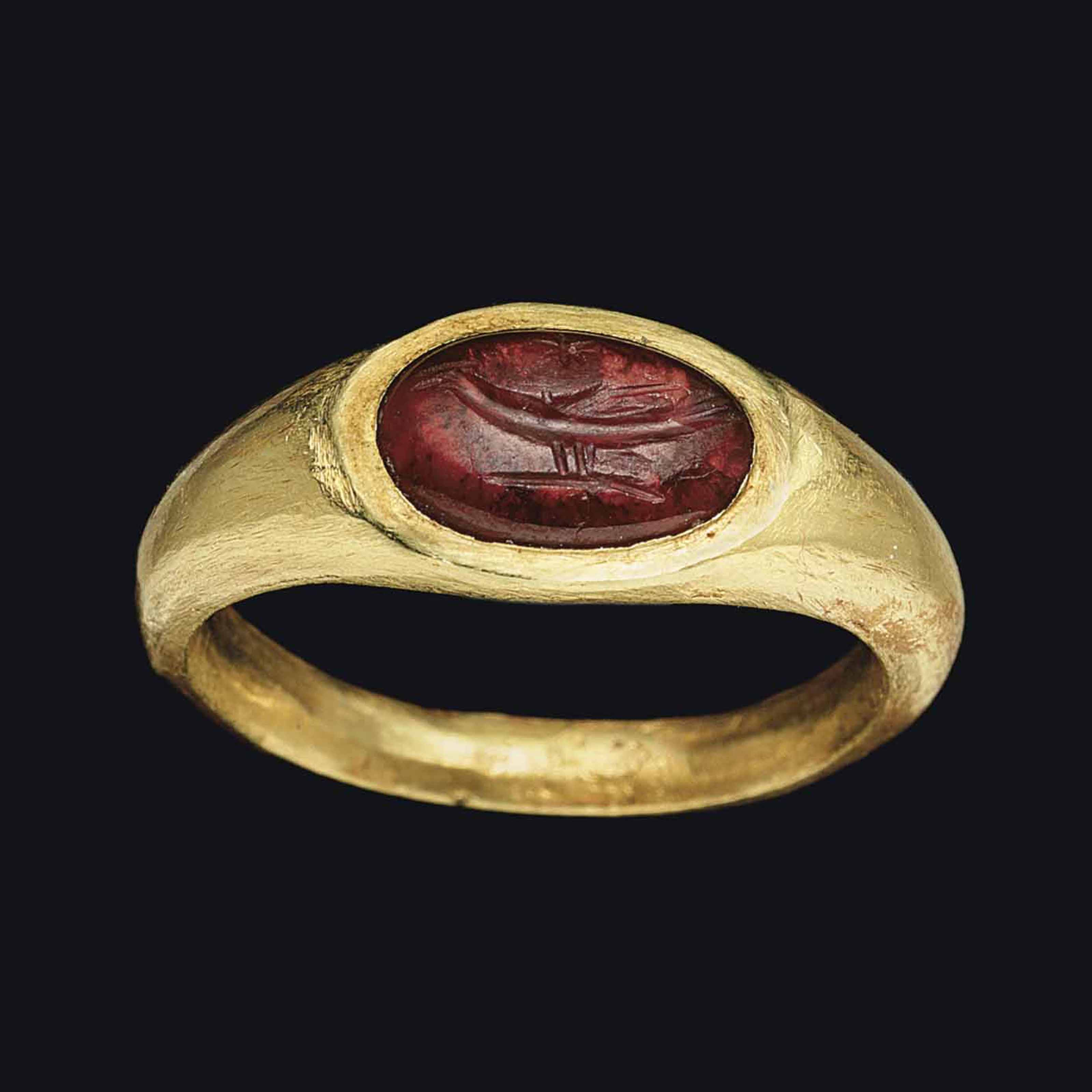 Ancient Roman Rings a roman gold and garnet finger ring | circa 2nd century a.d.