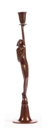 A bronze figural candlestick