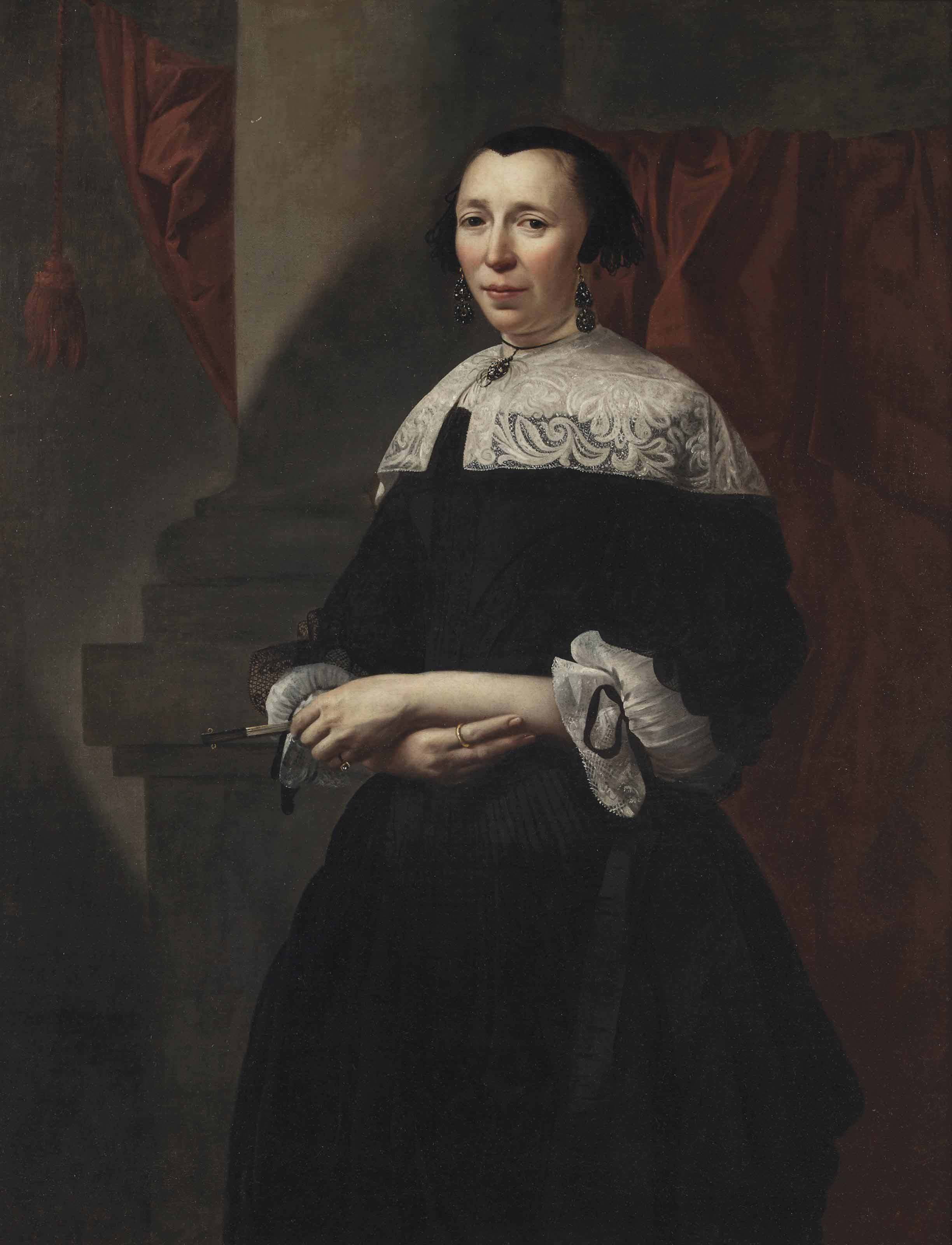 Portrait of a lady, three-quarter-length, in a black dress with white lace sleeves, a white lace collar and a black lace cap and wearing onyx earrings and necklace, holding a closed fan, standing before a column and a red curtain
