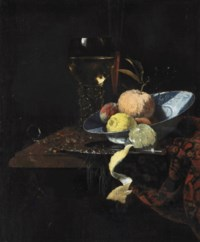 A Roemer, a glass flute, an orange, two peaches and a lemon in a blue and white wanli kraak charger with a knife and a partially peeled lemon on a silver platter, all on a partially draped stone ledge