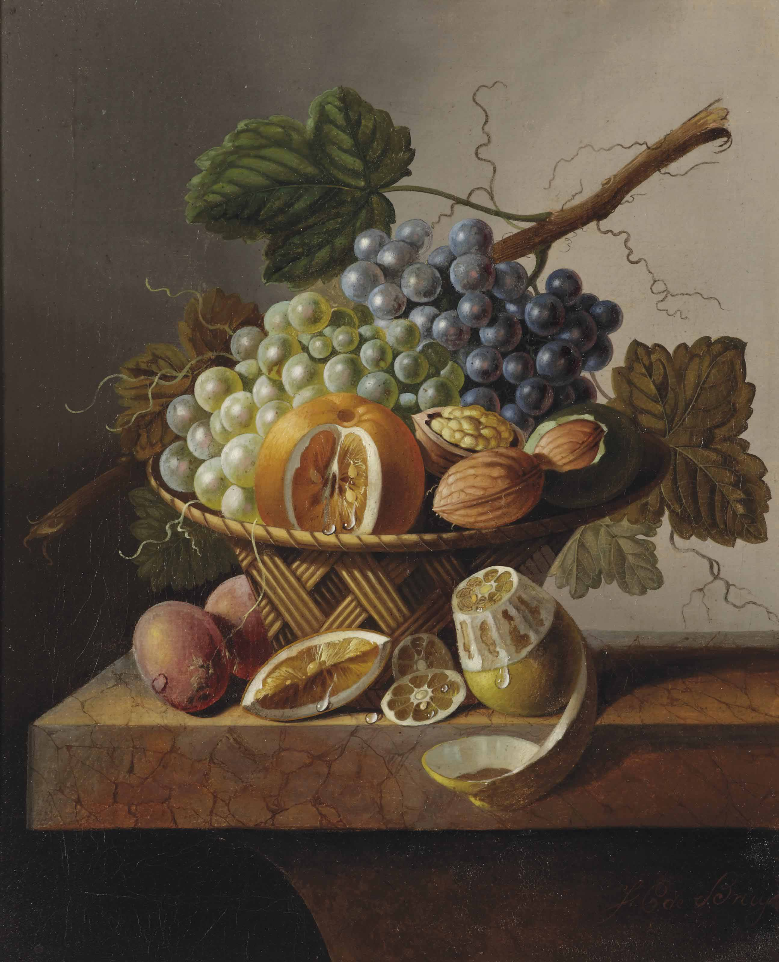 Grapes, an orange and walnuts in a wicker basket with a lemon and plums, all on a marble ledge