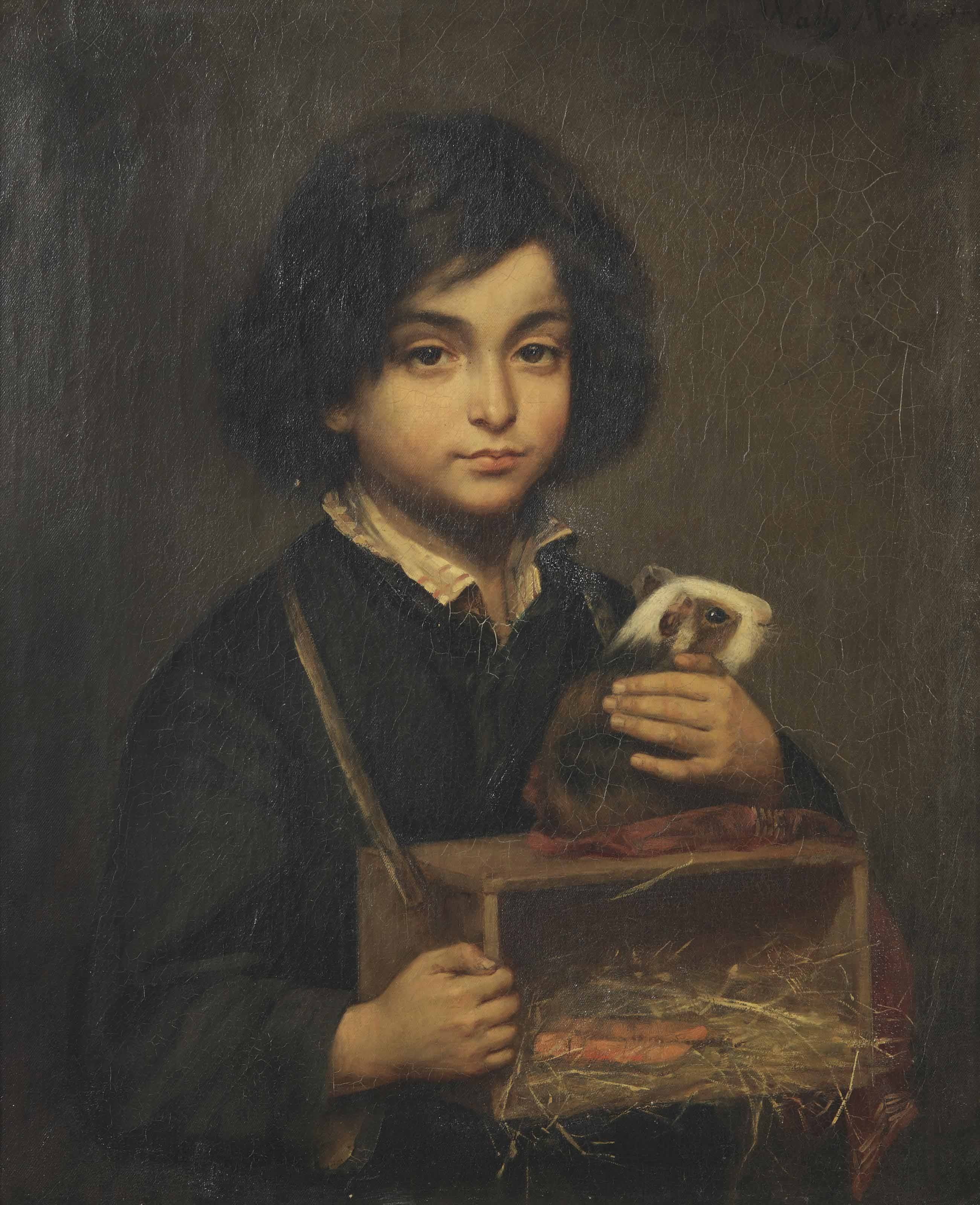 A boy with a guinea pig on it's cage