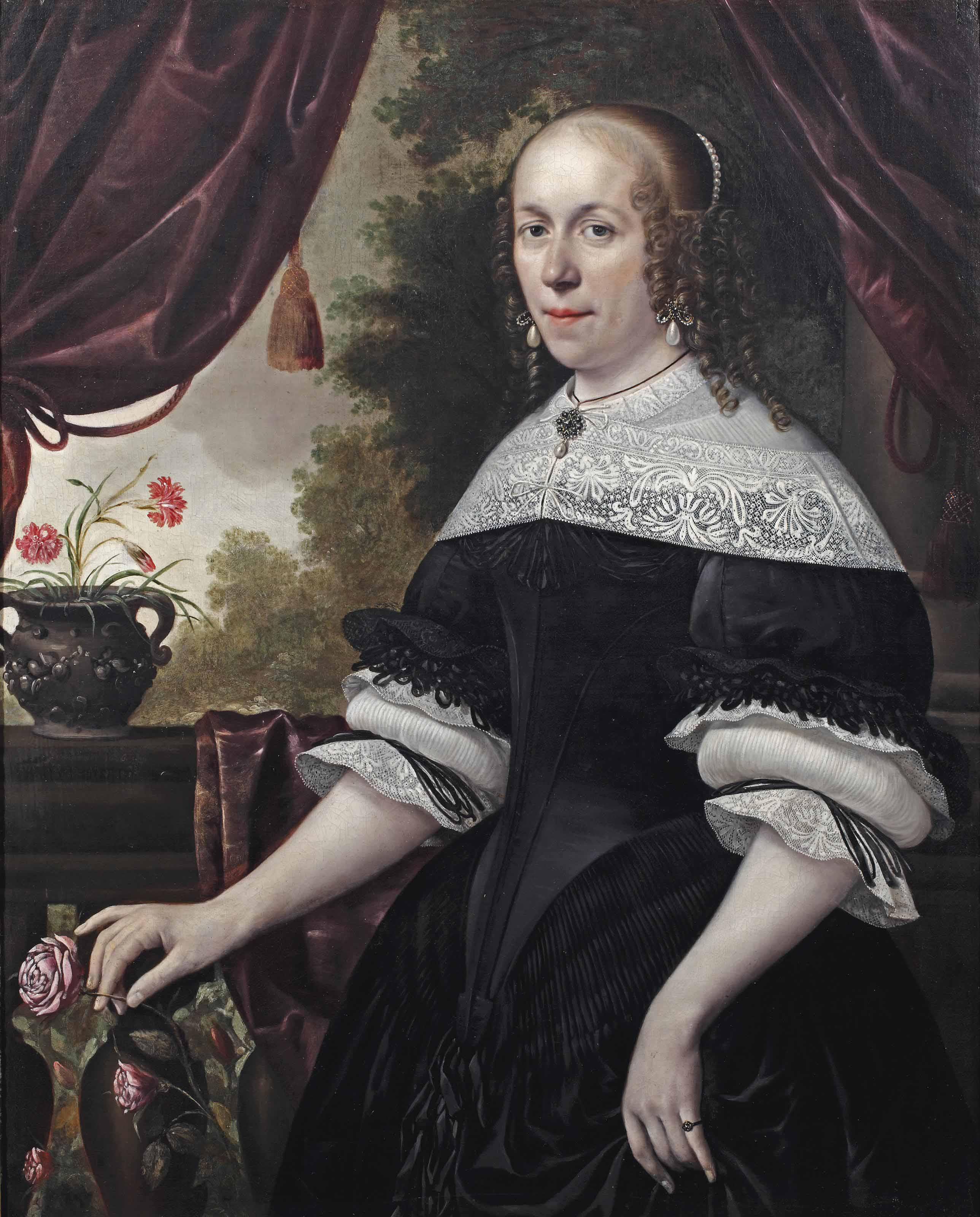 Portrait of a lady, three-quarter-length, in a black dress with white lace, a pearl and granite parure and pearls in her hair, holding a pink rose, a landscape beyond