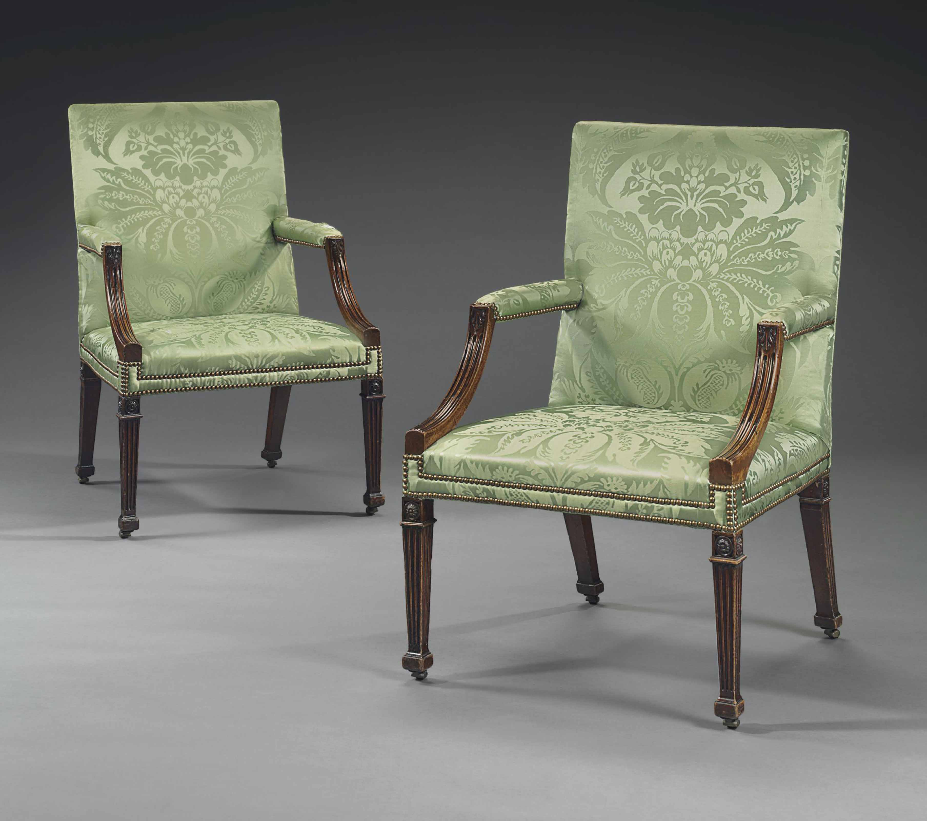 A PAIR OF GEORGE III MAHOGANY OPEN ARMCHAIRS