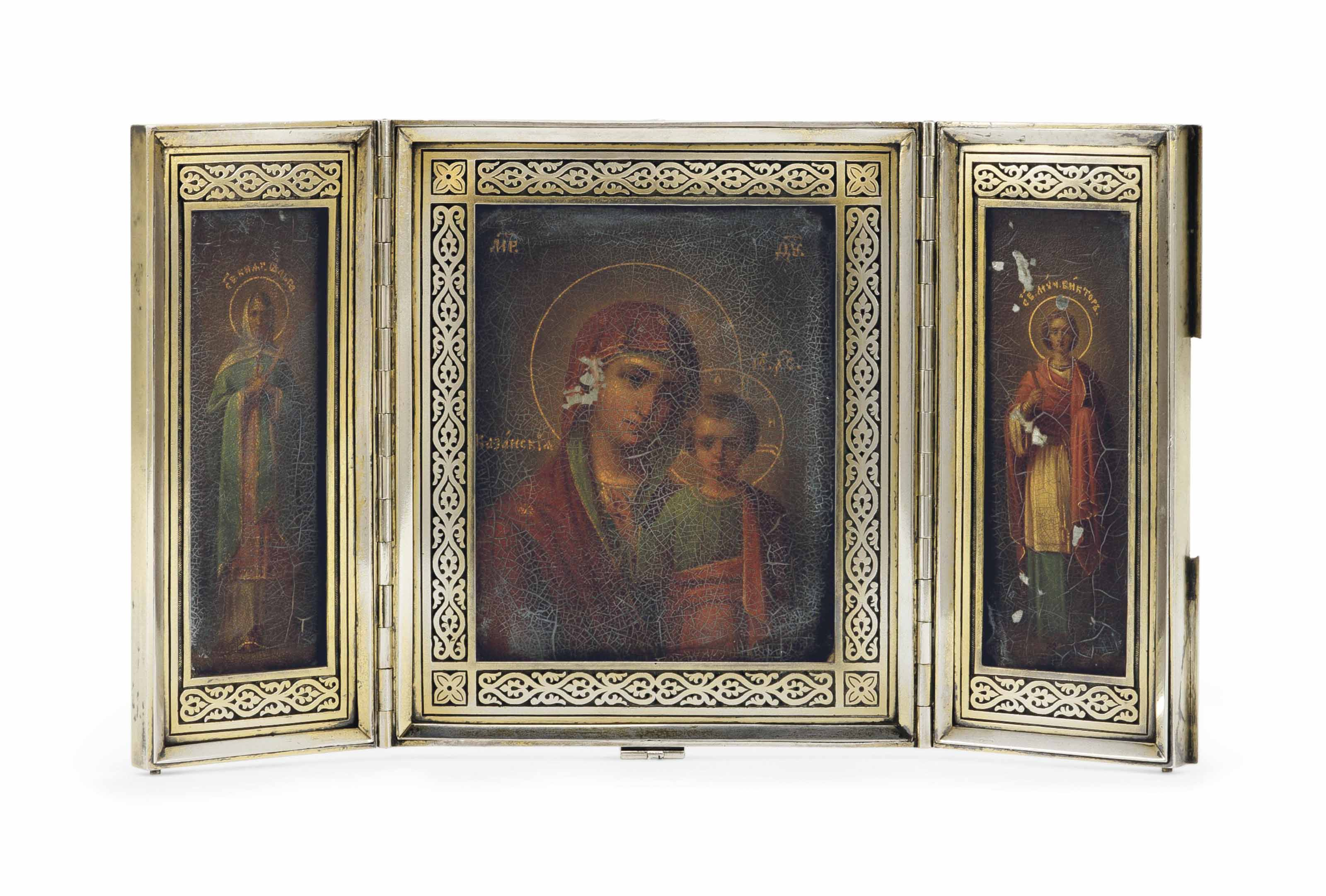 A PARCEL-GILT SILVER TRAVELLING TRIPTYCH