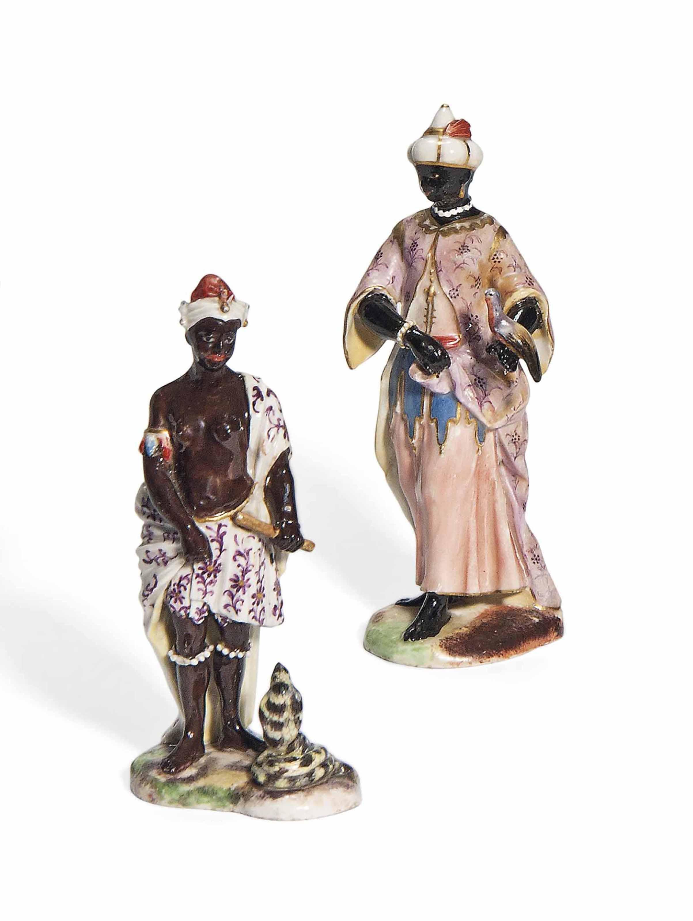 two german porcelain figures of blackamoors third quarter of the 18th century perhaps. Black Bedroom Furniture Sets. Home Design Ideas