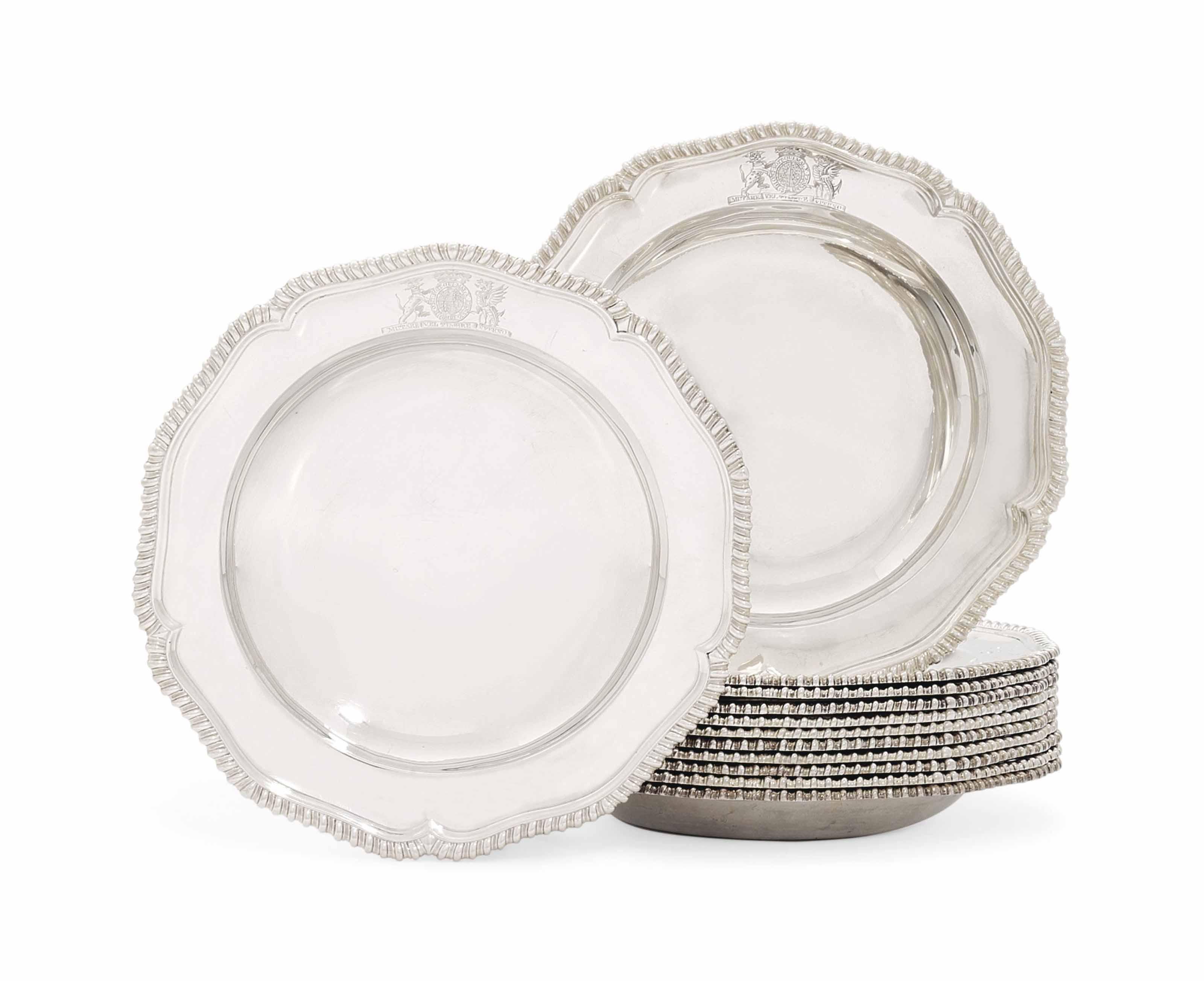A SET OF TWELVE GEORGE II SILVER SOUP-PLATES