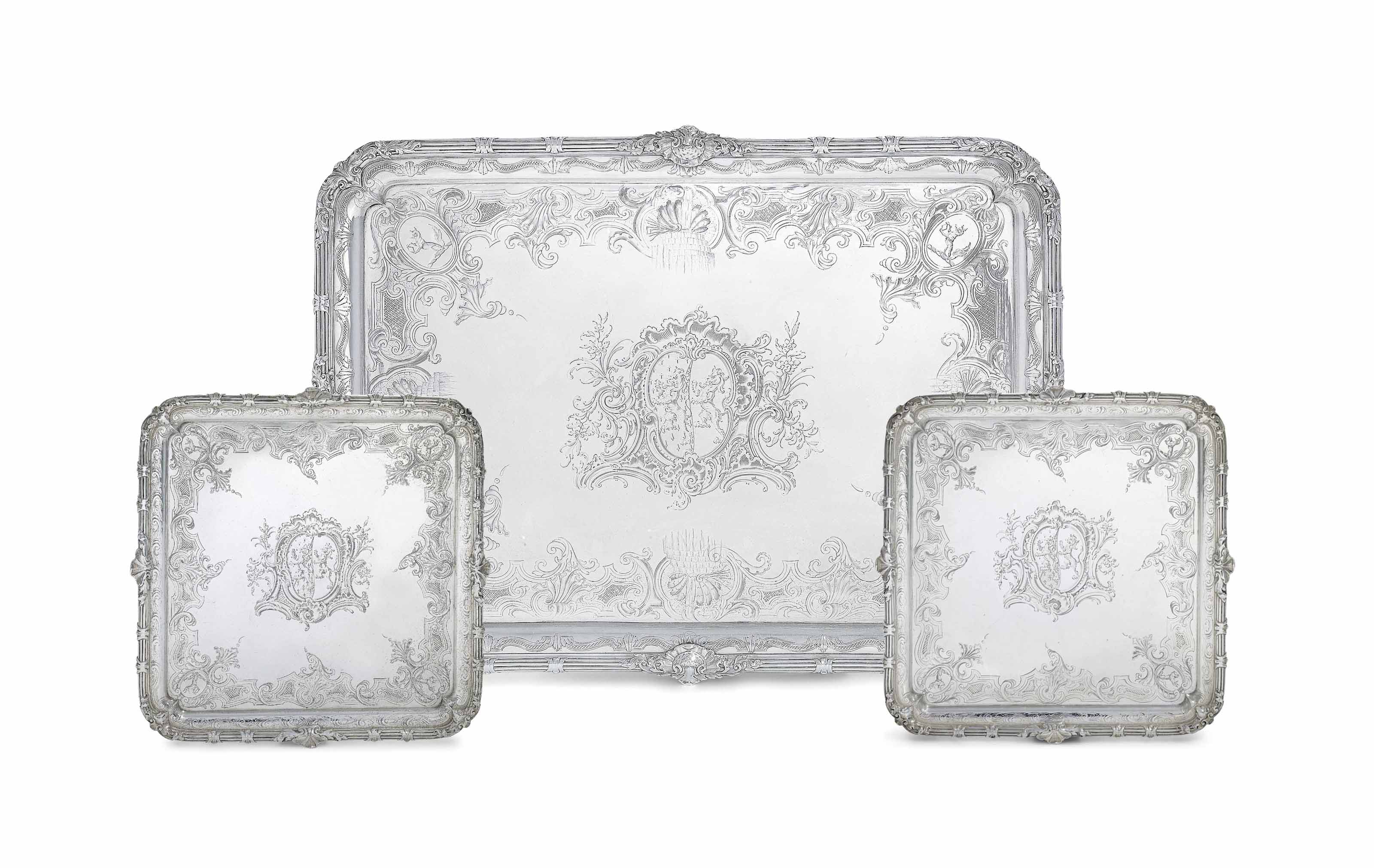 AN IMPORTANT GEORGE II SILVER TRAY AND A PAIR OF SALVERS EN SUITE