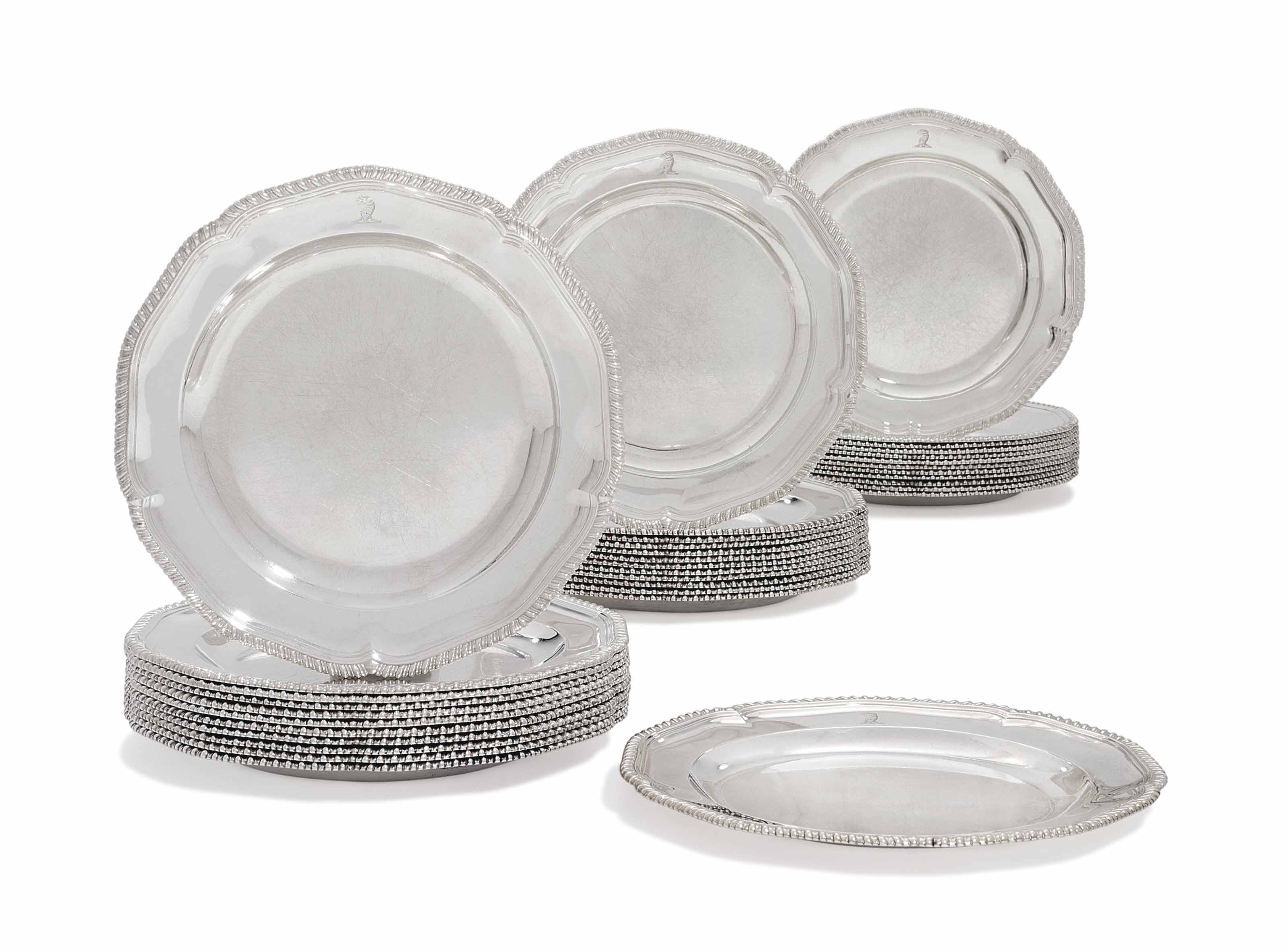 A SET OF THIRTY-SIX GEORGE III SILVER DINNER-PLATES