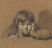 Portrait of a young boy, leaning on his elbow