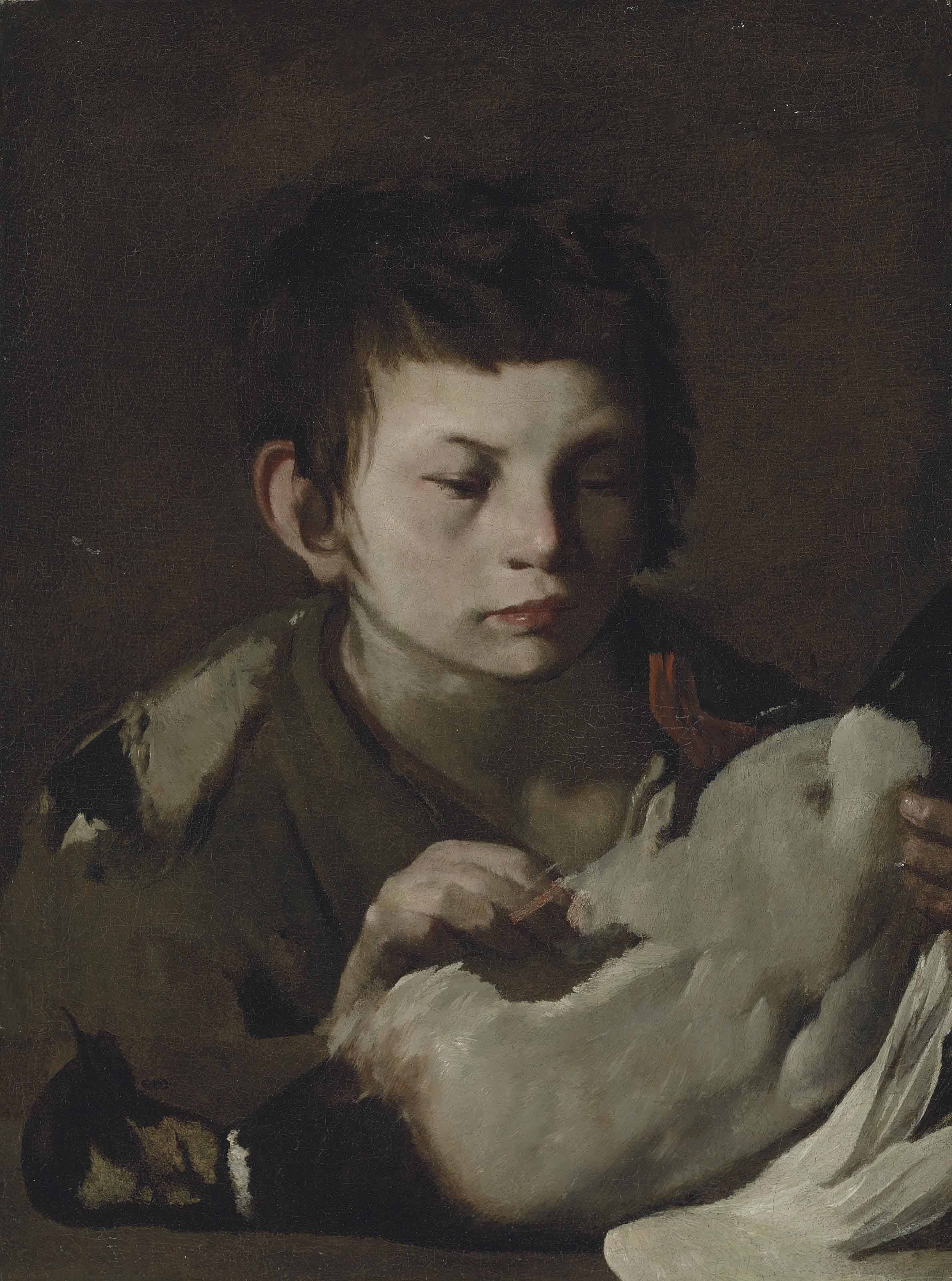 A young boy plucking a duck