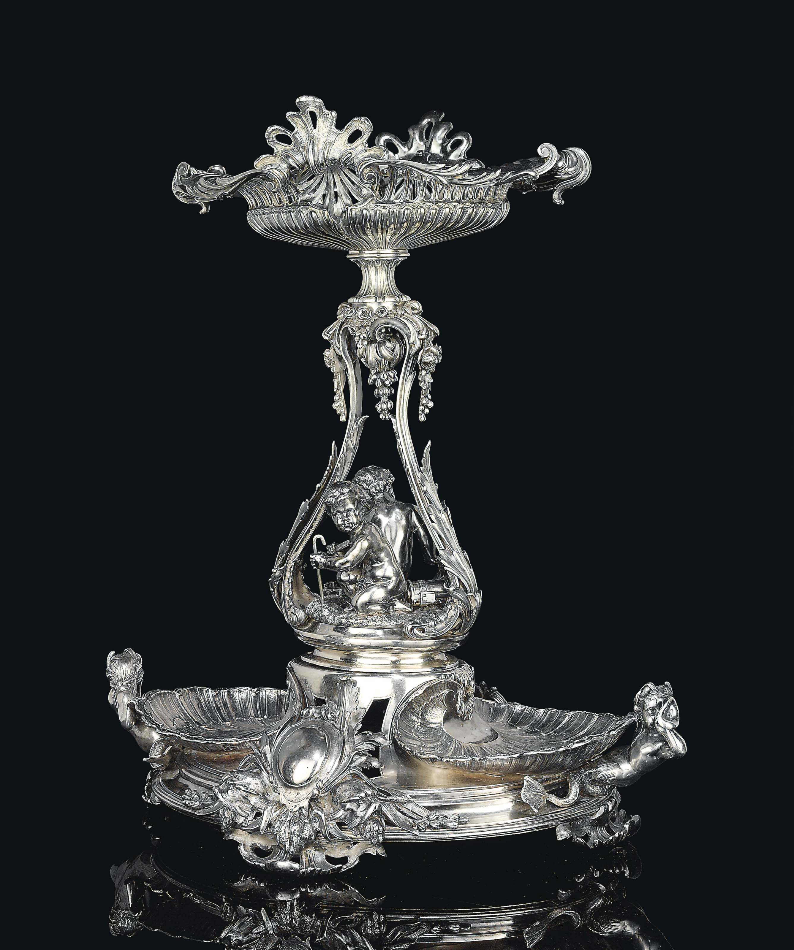 A NAPOLEON III ELECTROPLATED CENTREPIECE, TITLED 'CORBEILLE LOUIS XIV, DEUX COQUILLES, TRITONS ET DAUPHINS'