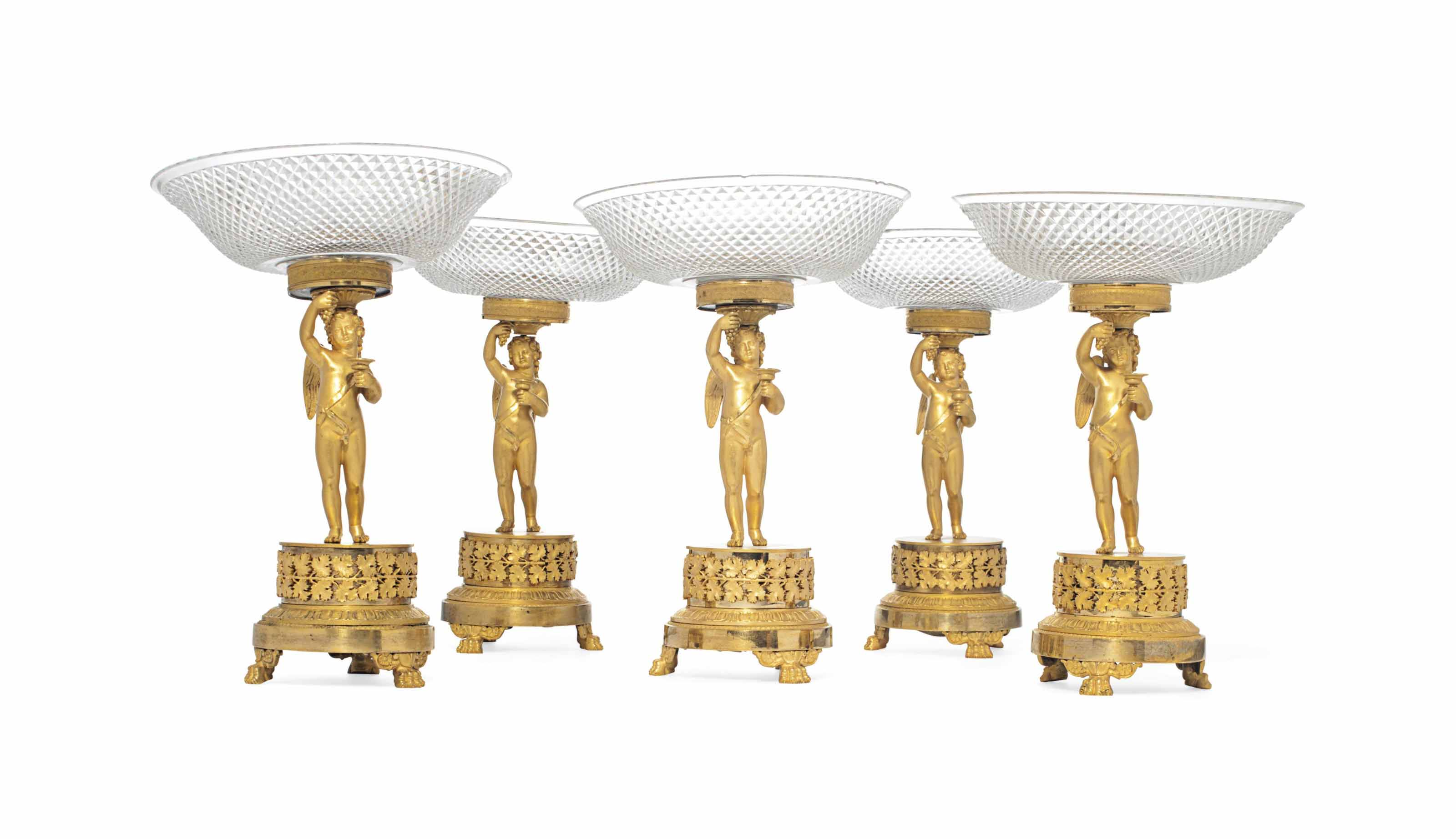 A SET OF SIX CHARLES X ORMOLU AND CUT-GLASS TAZZAS