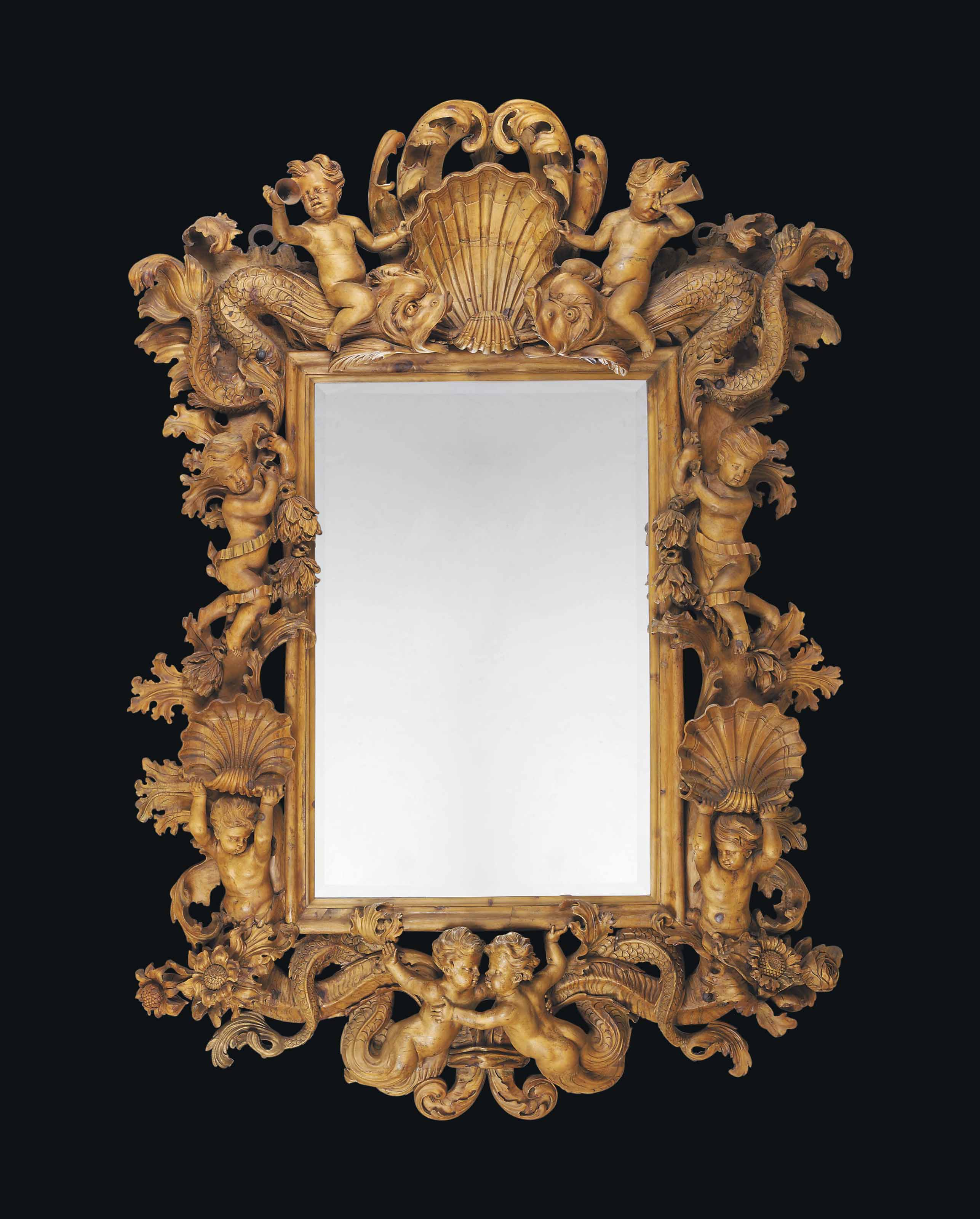 A LARGE NORTH ITALIAN CARVED PINE MIRROR