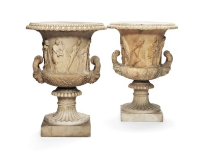 A PAIR OF ALABASTER MODELS OF