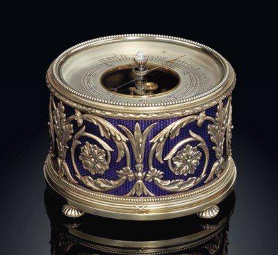 A GEM-SET SILVER-GILT AND GUIL