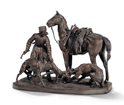 A BRONZE GROUP OF A HUNTER AND