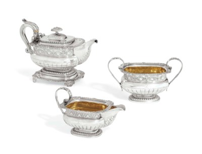 A GEORGE III FOUR PIECE SILVER