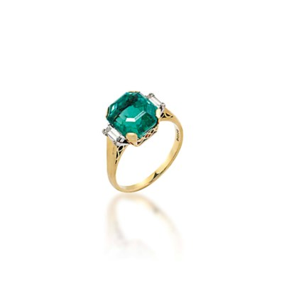 AN 18 CARAT GOLD EMERALD AND D